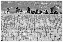 Wooden crosses, stars of David, and beachgoers. Santa Monica, Los Angeles, California, USA ( black and white)