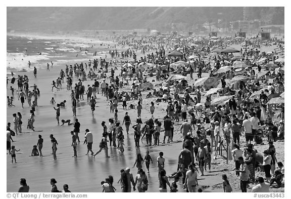 Dense crowds on beach. Santa Monica, Los Angeles, California, USA (black and white)