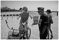Veteran for peace conversing with woman on bicycle. Santa Monica, Los Angeles, California, USA ( black and white)