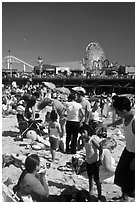 Families on beach and Pacific Park on Santa Monica Pier. Santa Monica, Los Angeles, California, USA ( black and white)