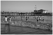 Beach shore and Santa Monica Pier, late afternoon. Santa Monica, Los Angeles, California, USA (black and white)