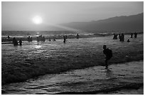 Sunset on beach shore, Santa Monica Beach. Santa Monica, Los Angeles, California, USA (black and white)