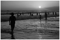 Ocean bathers at sunset, Santa Monica Beach. Santa Monica, Los Angeles, California, USA ( black and white)