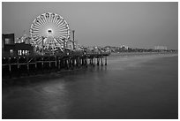 Ferris Wheel and beach at dusk, Santa Monica Pier. Santa Monica, Los Angeles, California, USA ( black and white)