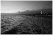 Ocean and beachfront at sunset. Santa Monica, Los Angeles, California, USA ( black and white)