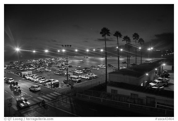 Beach Parking lot at sunset. Santa Monica, Los Angeles, California, USA (black and white)