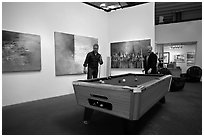 Playing pool inside a contemporary art gallery, Bergamot Station. Santa Monica, Los Angeles, California, USA (black and white)