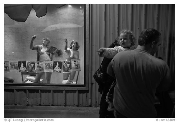 Toddler echoing performance artists, Bergamot Station. Santa Monica, Los Angeles, California, USA (black and white)