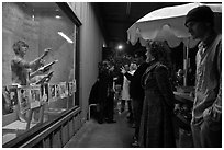 People watch performance artists in window, Bergamot Station. Santa Monica, Los Angeles, California, USA (black and white)