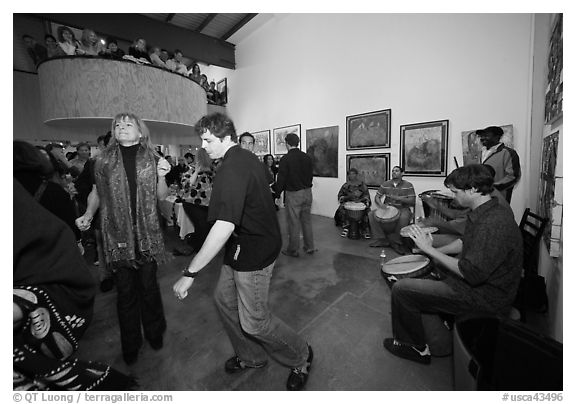 Guest dance to drums on art gallery opening night, Bergamot Station. Santa Monica, Los Angeles, California, USA