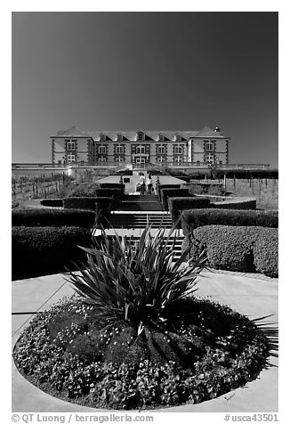 Domain Carneros winery with couple walking upstairs. Napa Valley, California, USA (black and white)