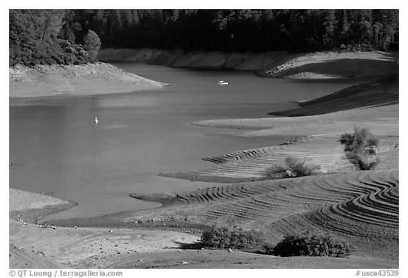 Red earth around an arm of Shasta Lake. California, USA (black and white)