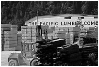 Lumber and forklift, Pacific Lumber Company, Scotia. California, USA ( black and white)