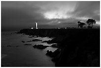 Coastal bluff with lighthouse at dusk, Point Arena. California, USA (black and white)