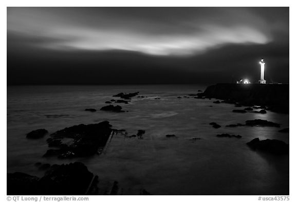 Night coastal scene with ocean and Lighthouse, Point Arena. California, USA (black and white)