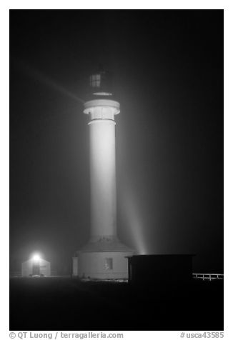 Point Arena Lighthouse on foggy night. California, USA (black and white)