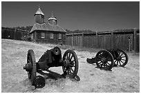 Cannons and chapel, Fort Ross Historical State Park. Sonoma Coast, California, USA ( black and white)