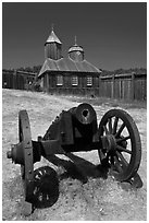 Cannon and Russian chapel inside Fort Ross. Sonoma Coast, California, USA (black and white)