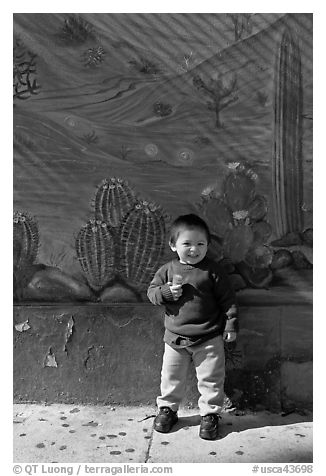 Boy and mural, Mission District. San Francisco, California, USA (black and white)