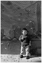 Boy and mural, Mission District. San Francisco, California, USA ( black and white)