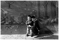 Boys and mural, Mission District. San Francisco, California, USA ( black and white)