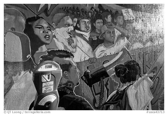Parking meter and politically charged mural, Mission District. San Francisco, California, USA (black and white)