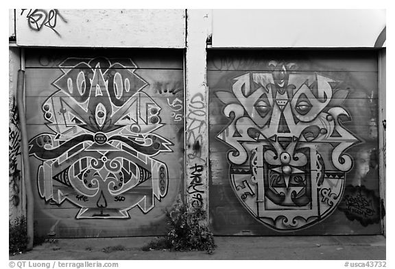 Two painted garage doors, Mission District. San Francisco, California, USA (black and white)