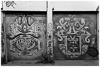 Two painted garage doors, Mission District. San Francisco, California, USA ( black and white)