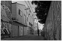 Man walking in alley, Mission District. San Francisco, California, USA ( black and white)
