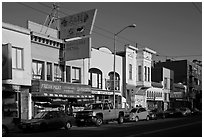 Shops, Mission Street, late afternoon, Mission District. San Francisco, California, USA (black and white)