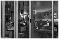 Cafe seen through windows, Mission District. San Francisco, California, USA (black and white)