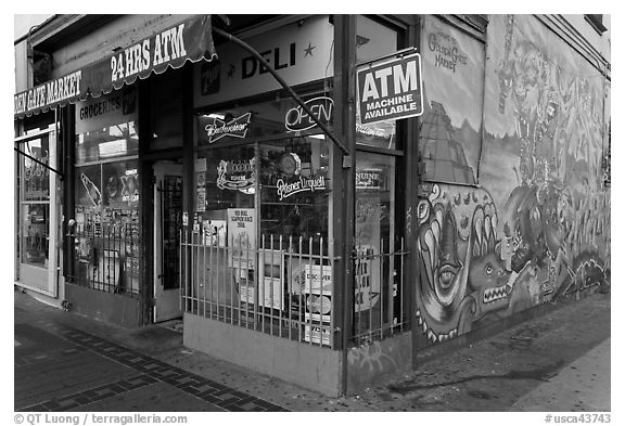 Corner store and mural, Mission District. San Francisco, California, USA (black and white)