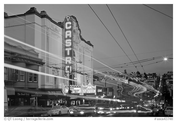 Traffic blurs and Castro Theater at dusk. San Francisco, California, USA (black and white)