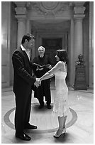 Bride, groom, and wedding officant, City Hall. San Francisco, California, USA ( black and white)