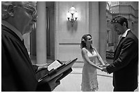 Officiant and couple getting married, City Hall. San Francisco, California, USA (black and white)