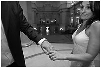Newly wed bride looks over rings, City Hall. San Francisco, California, USA (black and white)