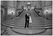 Just married couple at the base of the grand staircase, City Hall. San Francisco, California, USA ( black and white)
