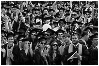 Graduating students wave to family and friends, commencement. Stanford University, California, USA (black and white)