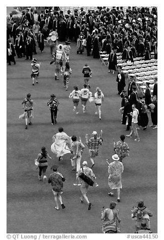 Band members run at the end of commencement ceremony. Stanford University, California, USA (black and white)