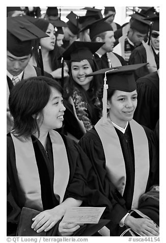 Students in academical dress sitting during graduation ceremony. Stanford University, California, USA (black and white)