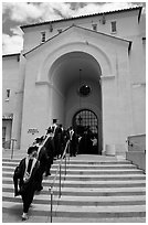 Graduating students in academic robes walk into Memorial auditorium. Stanford University, California, USA (black and white)