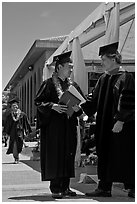 Graduate wearing lei presented with diploma. Stanford University, California, USA (black and white)