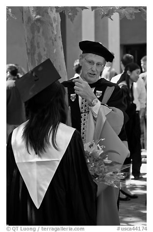 Faculty in academic dress talks with student. Stanford University, California, USA (black and white)