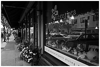Main street reflected in storefront. Half Moon Bay, California, USA ( black and white)