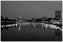 Oakland skyline reflected in Lake Meritt, twilight. Oakland, California, USA (black and white)