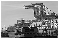 Cranes and cargo ship, Oakland port. Oakland, California, USA (black and white)