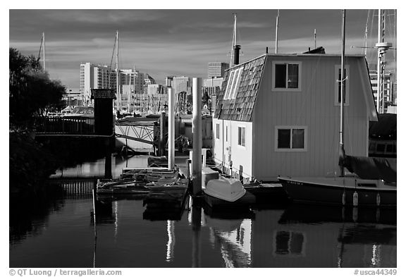 Houseboat and Oakland skyline. Oakland, California, USA (black and white)