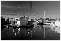 Alameda Houseboats and Oakland skyline. Oakland, California, USA (black and white)