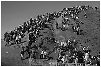 Crowds scrambling on hill during mavericks competition. Half Moon Bay, California, USA ( black and white)