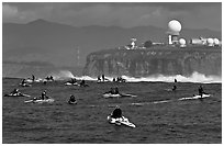 Flottila of personal watercraft near Mavericks break in front of  Pillar Point air force station. Half Moon Bay, California, USA ( black and white)